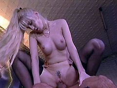 Slutty Tara Moon takes off a lingerie and sucks a dick sitting on her knees. This horny MILF also allows a guy to fuck her in both holes.