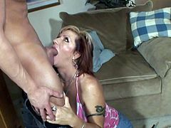 Share this with your friends! A curvy cougar, with big tits wearing a miniskirt, while she gets fucked in her living room before her cuckold comes in.