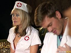 Curvy mom Emma Butt wearing a nurse uniform and glasses is having fun with a guy indoors. She pleases him with a blowjob, then they bang in the reverse cowgirl and other positions.