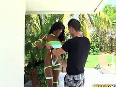 Naughty black bitch looks damn hot and sexy wearing crotchless bikini. She kneels down right on a terrace outdoor taking meaty cock in her mouth. She sucks it greedily.