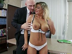 Bosomy blond MILF Kristal Summers gets her mouth attacked by long cock