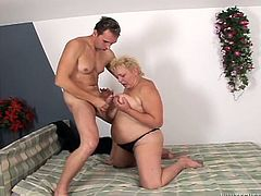 Short haired fat bitch with huge tits gives blowjob to stud. BBW hoe plays with her udders while her dirty hairy cunt gets railed missionary style.