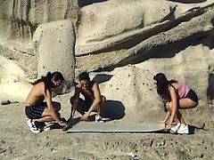 Sizzling teen threesome fun on the beach. What a lovely view to fuck such horny brunette! Watch these 3 go to a remote part of the beach and have some fun!