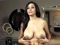 Perverted and zealous brunette Raylene takes off her lacy underwear, plays with her big tits and starts fungering her shaved pussy.