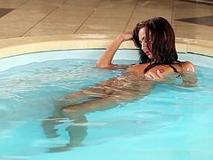 Watch Michaela Isizzu taking a dip in the pool and as she comes out, see how she takes off her her bikini. Get a load of this gorgeous babe's amazing body in this erotic solo scene.