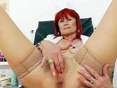 Things are pretty intense for sleazy mature Milada which is near to cracking her cramped cunt in solo