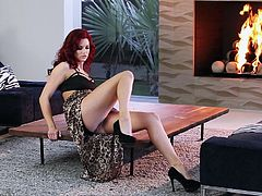 Glamorous Jayden Cole pulls down a dress to show her perfect boobs. Then she lies down on a coffee table and lifts up a dress to show her smooth pussy.