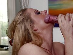 Holly Heart and Chad Alva are getting naughty indoors. The gorgeous blonde kneels in front of the dude and sucks his weiner till it explodes with cum.