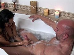 Brunette angel is a true master in sliding her soft hands all the way hunk's huge dong in perfect massage in the tub