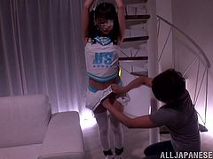 Make sure you have a look at this hot scene where this Asian babe is tied up and masturbates by this guy while she wears a sexy cheerleading outfit.
