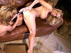 Hope you ready to bust a serious nut with this hot scene where these gorgeous blondes have lesbian sex on a couch.