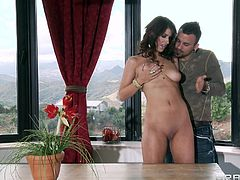 Sexy dark-haired milf Karina White, wearing a bikini, is having fun with guy called Voodoo outdoors. She favours the dude with a blowjob and a handjob, then they bang in the cowgirl position and doggy style.