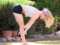 Have a look at this erotic solo scene where the gorgeous blonde teen Bella does yoga on her garden butt naked as you feel a boner coming on.