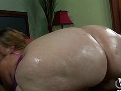 She washes her giant fat ass and gets it all soapy. She gets out of the shower and her man puts oil all over her fat rolls instead. The bbw needs a cock in her mouth now so she goes over to see her boyfriend and sucks his big black cock.