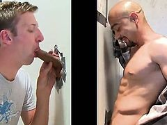 Take a look at this hot gay gloryhole scene where this horny twink sucks on this guy's big fat cock poking out of the wall.