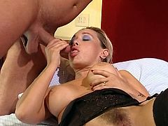 A blonde MILF in stockings sucks a huge dick in a bedroom. Then Melissa gets her hairy pussy licked and fucked.