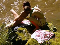 The teen lesbians are slowly undressing but ended up licking each other's pussies instead of swimming. Watch their intense amateur and outdoor sex!
