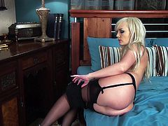 Magnificent blonde babe in garter belt and stockings, black dress and high heels makes great solo show. She fingers her soaking wet pussy and shows it in close-up scenes.