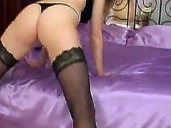 A nice blonde girl in stockings shows her big natural boobs and feet. Petra also toys her pussy with a glass dildo.
