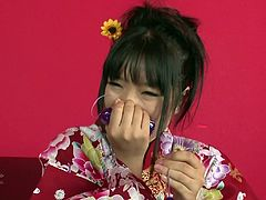 This chick looks very tempting wearing her beautiful kimono. Horny dude tickles her hairy snatch with her vibrating eggs.