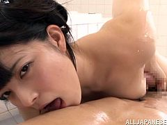 Adorable Japanese girl oils her body and rubs her nice natural tits against her man's cock. Then they fuck in the missionary position and the cutie moans sweetly with pleasure.