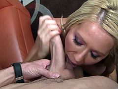Busty blonde milf Ashley Winters is trying to milk this wang dry on her face. She sucks and rubs it ardently and then takes it in between her big fake tits and massages it.