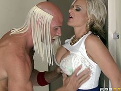 Busty blonde milf Kate Frost is having fun with Johnny Sins, who is wearing a costume and a wig. Kate gives a blowjob to Johnny, then lets him drive his dick in her snatch and enjoys it deep.