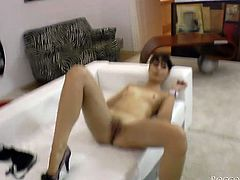 Sweet black haired girl with charming eyes tries to take Rocco Siffredi's 9 inch tool up her mouth. Cutie chokes on that massive dick and then gets her kitty fucked doggystyle.