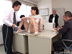 Things get red hot in the office when the guys gather around so they can finger, toy, then cum all over their hot secretary.