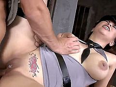Whorish tattooed asian Tigerr Benson with huge fake tits in sexy police uniform and high heels gives head to muscled fucker and gets her pierced cunt fucked hard in close up.