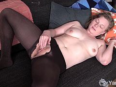 Lili is a cute amateur with big natural boobs and a delicious shaven pussy. She wears tights when she masturbates. A hole allows her access to stroking her clit.