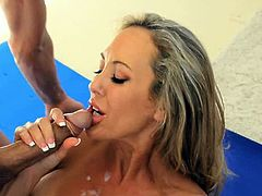 Brandi Love is a personal trainer in perfect shape. She's an extremely attractive cougar who seduces her client. He has a huge cock that she enjoys taking in her cunt.