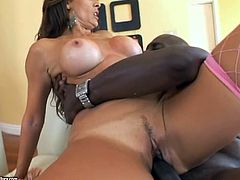Get excited by watching this brunette cougar, with gigantic boobs wearing fishnet stockings, while she goes hardcore over a couch.