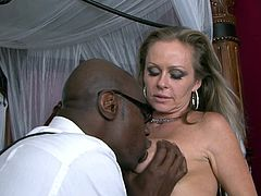 Since her hubby is away, voluptuous cougar thinks of smashing her pussy with the black neighbour's dong