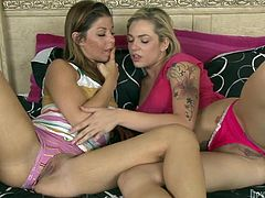 Two cute looking leggy lesbians masturbate lying in bed close to each other. Sluts get really horny and decide to diddle each other's tight meaty muffs.