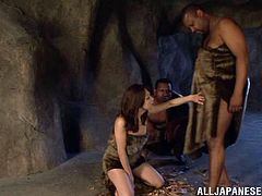 A kinky Japanese chick, wearing furs, is having fun with a guy in a cave. She kneels in front of the man and pleases him with a hot blowjob.