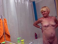 This old, mature slut has been around and done things with her mouth and cunt you couldn't even imagine. she gets in the showed and is filmed completely in the nude. She shows off her saggy, wrinkly tits, and she washes her weathered pussy.
