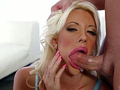 This stunning blonde beauty wants a fresh load of proteine in her mouth. She takes her lover's dick in her filthy mouth and starts to suck it passionately. Such a dirty whore!