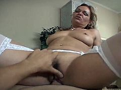Voracious MILF with ample booty is riding hard dong on top
