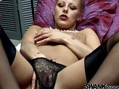 Slutty blonde wearing sexy black lingerie and a pearl necklace fingers her big juicy pussy and sucks her filthy fingers.