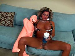 Kinky shemale bitch with big fake tits is stroking her hard cock intensively. She also pokes her ass hole with smooth dildo.