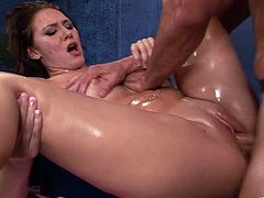 Dark-haired milf Katie Summers gets her body oiled and massaged. Then the masseur fingers Katie's snatch and drills it in the missionary position.