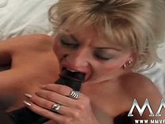 Nikita is in a room full of antiques. A black man joins her and has her suck on his swollen stick. He inserts it inside her butt hole after pounding her pussy a while.