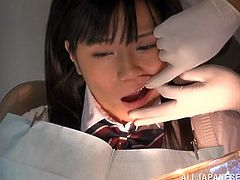 An Asian teen in a college uniform gets seduced at a medical examination. A tricky doctor fingers and fucks the girl in front of the nurses.