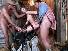 Take a look at this hardcore scene where the slutty Dona Bell is fucked silly by two guys in a threesome in a barn where she's even double penetrated.