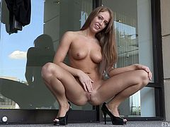 Get a load of Kiera's sexy body in this solo scene as she pulls up her dress before fingering herself out in public.