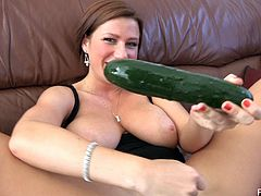 A curvaceous MILF shows off her big hanging boobs. She lies down on a sofa and makes herself cum using a big cucumber.