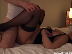 Gorgeous Asian babe in sexy black lingerie gives a hot blowjob and gets her hairy wet pussy licked and fucked doggystyle.