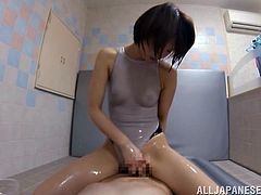 A short-haired Japanese girl oils her body up in a bathroom. This Asian girl takes off a swimsuit and gets fucked in her tight pussy.