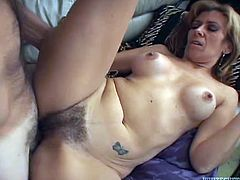 Sensual busty milf gets her muff drilled hard missionary style. His meaty shaft penetrates her slit and she moans under the waves of pleasure.